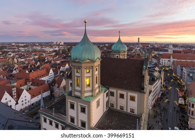 Augsburg town hall and streets with Christmas decorations seen from Perlach Tower (Perlachturm) at sunset with colorful sky, Augsburg, Bavaria, Germany