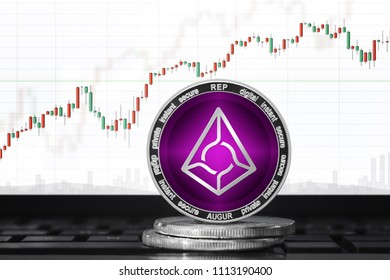 AUGUR coin; augur (REP) cryptocurrency on the background of the trading chart