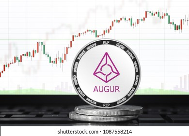 AUGUR (REP) cryptocurrency; physical concept augur coin on the background of the chart