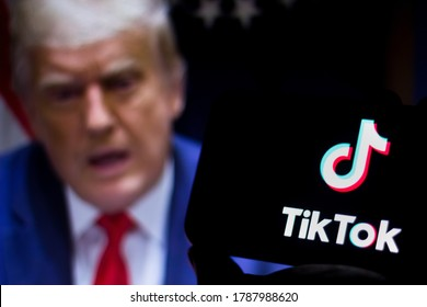 August 1, 2020, Brazil. In this photo illustration the TikTok logo seen displayed on a smartphone. United States President Donald Trump appears in the background. He said he will ban TikTok in the USA