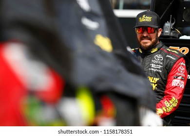 August 10, 2018 - Brooklyn, Michigan, USA: Martin Truex, Jr (78) hangs out on pit road before qualifying for the Consumers Energy 400 at Michigan International Speedway in Brooklyn, Michigan.