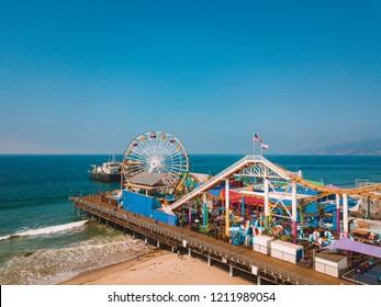August 10, 2018. Los Angeles, California. Aerial view of the Santa Monica pier with amusement park, ferris wheel, roller coaster and people having fun near Venice beach.