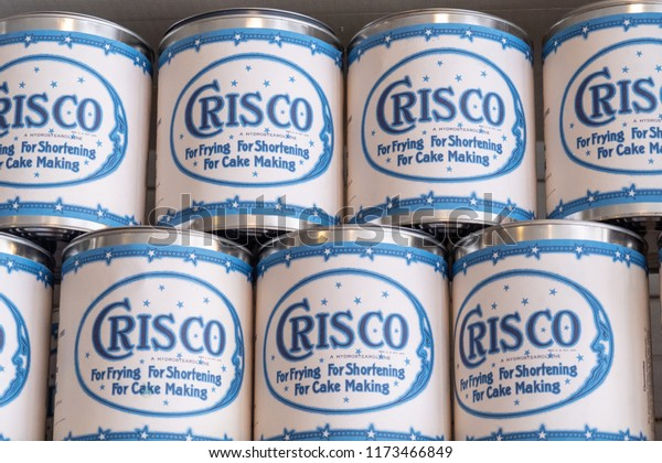 AUGUST 10 2018 - MCCARTHY, ALASKA: Vintage jars with old packaging of Crisco vegetable oil shortening stacked on shelves