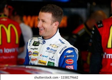 August 11, 2018 - Brooklyn, Michigan, USA: AJ Allmendinger (47) hangs out in the garage prior to practice for the Consumers Energy 400 at Michigan International Speedway in Brooklyn, Michigan.