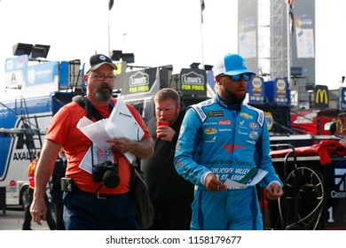 August 11, 2018 - Brooklyn, Michigan, USA: Darrell Wallace, Jr (43) hangs out in the garage prior to practice for the Consumers Energy 400 at Michigan International Speedway in Brooklyn, Michigan.