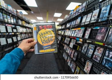 AUGUST 11 2018 - FAIRBANKS ALASKA: Female hand holds up a DVD rental case for sale at a closing Blockbuster Video store during its final days of business