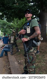 August 12, 2017 Charlottesville, Virginia USA - Armed militia with assault rifles defending right to bare arms to protect the people.