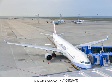 August 12, 2017 : Chubu Centrair International Airport in Aichi, Japan,  Air China a330 plane is parking at the gate at Chubu Centrair International Airport with areobridge for boarding passenger