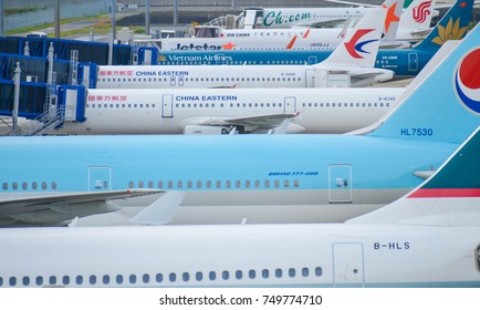 August 12, 2017 : Chubu Centrair International Airport in Aichi, Japan, Many airline's airplane is parking waiting for their passenger in the airport in summer sunshine day