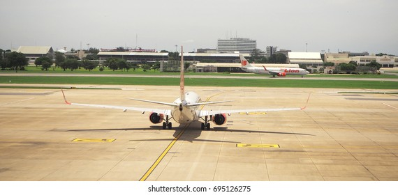 August 12, 2017 Don Mueng Airport, BANGKOK, THAILAND : The back of an airplane of Thai Lion Air is waiting on the runway  to go for taking off with background of same company plane.