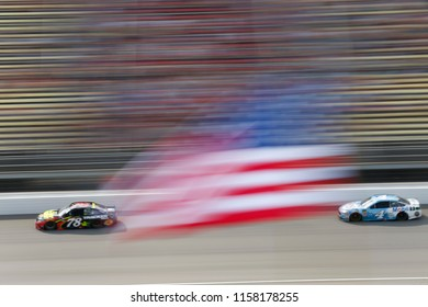 August 12, 2018 - Brooklyn, Michigan, USA: Martin Truex, Jr (78) brings his race car down the front stretch during the Consumers Energy 400 at Michigan International Speedway in Brooklyn, Michigan.