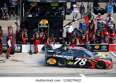 August 12, 2018 - Brooklyn, Michigan, USA: Martin Truex, Jr (78) comes down pit road for service during the Consumers Energy 400 at Michigan International Speedway in Brooklyn, Michigan.