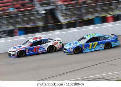 August 12, 2018 - Brooklyn, Michigan, USA: Ricky Stenhouse, Jr (17) and AJ Allmendinger (47) battle for position during the Consumers Energy 400 at Michigan International Speedway