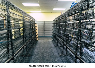 AUGUST 12 2018 - FAIRBANKS ALASKA: Empty video rental shelves inside of a closing Blockbuster Video store during its going out of business sale