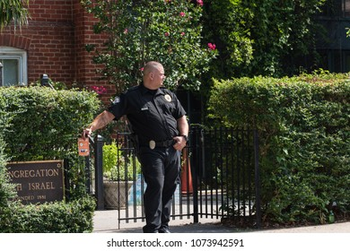 August 12,2017 Charlottesville, Virginia Emancipation ( Lee ) Park Charlottesville Police officer guarding Beth Israel Temple Jewish Synagogue down the street from Unite the Right demonstration.