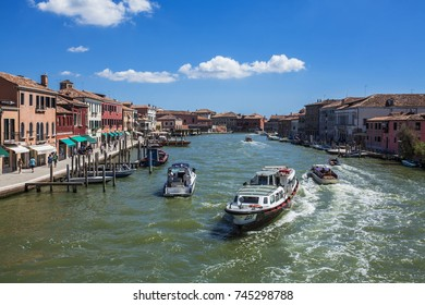 AUGUST, 13 2017, Summer in Venice: View from a bridge in Murano, overlooking the Grand Canal, Venice, Italy