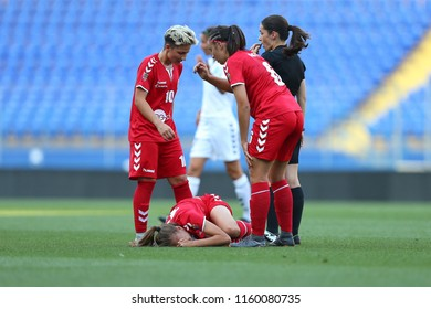 AUGUST 13, 2018 - KHARKIV, UKRAINE: Maria Neacsu. lying on pitch. Terrible sprained ankle ligament injury rupture of defender. UEFA Women's Champions League. WFC Kharkiv - Olimpia Cluj.