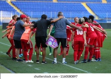 AUGUST 13, 2018 - KHARKIV, UKRAINE: WFC Olimpia Cluj players staying in energetic circle before match. UEFA Women's Champions League. WFC Kharkiv - Olimpia Cluj.