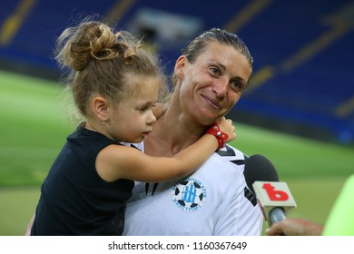 AUGUST 13, 2018 - KHARKIV, UKRAINE: Happy Iya Andrushchak with baby on hands giving interview. UEFA Women's Champions League. WFC Kharkiv - Olimpia Cluj.