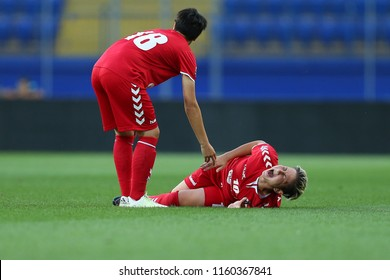 AUGUST 13, 2018 - KHARKIV, UKRAINE: Andreea Voicu lies on the ground with screams after getting terrible broken leg injury. UEFA Women's Champions League. WFC Kharkiv - Olimpia Cluj.
