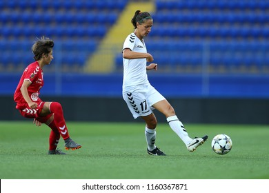 AUGUST 13, 2018 - KHARKIV, UKRAINE: Daryna Apanaschenko passes the ball marked by opponent. UEFA Women's Champions League. WFC Kharkiv - Olimpia Cluj.