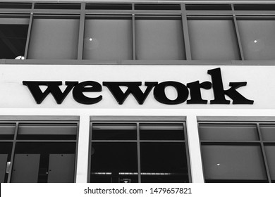August 14, 2019 San Mateo / CA / USA - Sign posted at an WeWork office building located in Silicon Valley; WeWork is an American company that provides shared workspaces; black and white