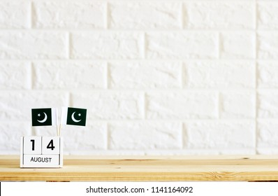 AUGUST 14 Wooden calendar Concept Pakistan national day.Copy space,minimal style