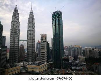 August 15, 2017 - Kuala Lumpur, Malaysia. Petronas Twin Towers view can be enjoyed by tourists at nearby skyscrapers (Traders Hotel).