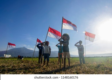 August 15, 2017, a number of children pay homage to the flag of Indonesia as a form of commemoration of Independence Day. Located in Kesongo Village, Kab. Semarang, Central Java Indonesia.