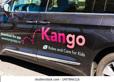 August 15, 2019 San Mateo / CA / USA - Close up of Kango logo on the door of one of the Company's cars; Kango is a kids' ride-hail app that doubles as a childcare service operating in Silicon Valley