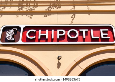 August 15, 2019 San Mateo / CA / USA - Close up of Chipotle sign at one of their restaurant location in San Francisco Bay; Chipotle Mexican Grill, Inc is an American chain of fast casual restaurants