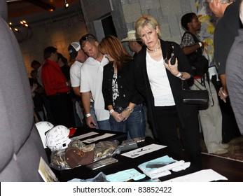 """August 16, 2011 - Athens, GA - Fans and friends bid on items up for silent auction. Country artist Colt Ford rounded up his friends to hold a benefit for the family of Elmer """"Buddy"""" Christian."""
