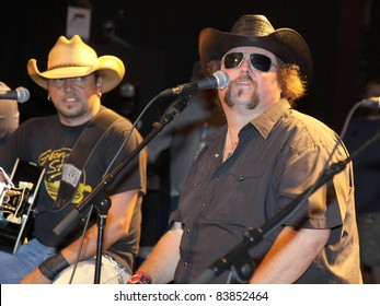 """August 16, 2011 - Athens, GA - Jason Aldean and Colt Ford. Country artist Colt Ford rounded up his friends to hold a benefit for the family of Elmer """"Buddy"""" Christian."""