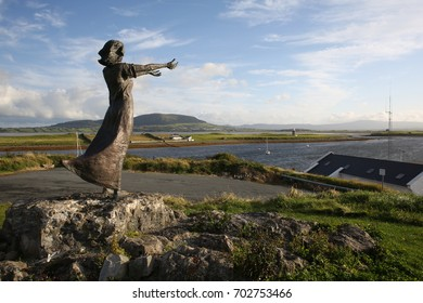 August 16, 2017 Rosses Point, Sligo, Ireland A panorama landscape scene at Rosses Point, Sligo,  in which a statue of a woman points towards the ocean.It was made by Niall Bruton.