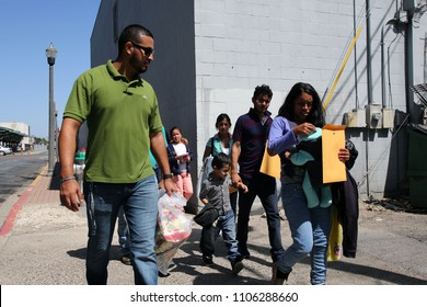 August 17, 2017 - McAllen, Texas, USA - A volunteer with a Catholic Charities' Humanitarian Respite Center leads a group of Central American refugees to the center to wait for buses to U.S. family.