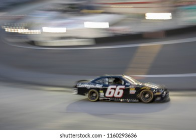 August 17, 2018 - Long Pond, Pennsylvania, USA: Tim Cowen (66) races through the field off turn four at the Gander Outdoors 400 at Pocono Raceway in Long Pond, Pennsylvania.