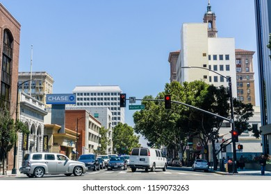 August 17, 2018 San Jose / CA / USA - Busy street lined up with tall buildings in downtown San Jose on a sunny day, Silicon Valley