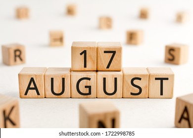 August 17 - from wooden blocks with letters, important date concept, white background random letters around