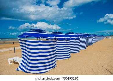 AUGUST 18, 2017: White beach huts in Cabourg Normandie, France, Europe