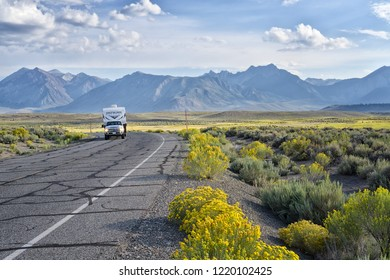 August 18, 2018 - MAMMOTH LAKES, CA - Road at Benton Crossing with camping car with yellow meadows, Yosemite, Nevada.