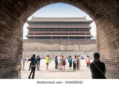August 19, 2015.  Xian, China. People visiting the Yong ning nan men or south gate at the Xian city wall near the south gate lit up at night in Shaanxi Province China.