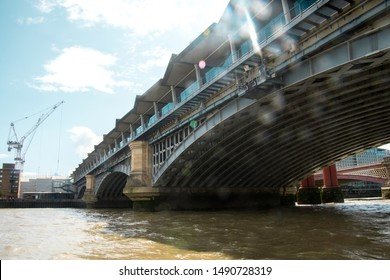 August 19, 2019 – River Thames, London, United Kingdom. One of the many many bridges that cross over the famous River Thames in the center of London, UK.