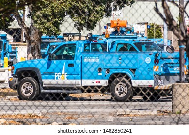 August 19, 2019 San Mateo / CA / USA - PG&E (Pacific Gas and Electric Company) service vehicle and other maintenance equipment stationed behind a wire fence in San Francisco bay area
