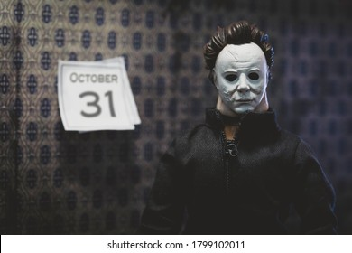 AUGUST 19 2020: Halloween movie concept with slasher Michael Myers and October 31 calendar - custom action figure Funko Savage head