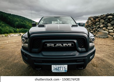 August 19th 2019. Rangely Maine USA. black 2020 Dodge Ram 1500 driving down a dirt country road in the mountains during the evening sunset using 4x4 vehicle capabilities. four wheel drive.