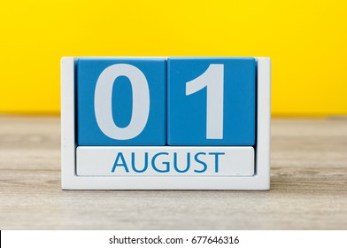 August 1st. Image of august 1, close-up wooden color calendar on yellow background. Summer day