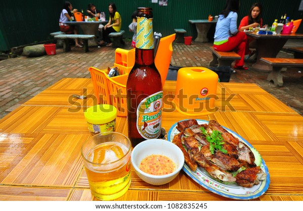 August 20, 2012 - Luang Prabang, Laos : The BeerLao and Ping Ped (Grilled Duck) on the table in laos street food restaurant.