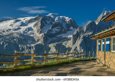 August 20, 2014: Early morning view of Marmolada mountain massif with Punta Penia & Gran Vernel summits & Viel del Pan refuge as seen from trail #601 to Pordoi pass, Dolomites, Italy