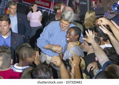 AUGUST 2004 - Senator John Kerry embraces African-American child at the Thomas Mack Center at UNLV, Las Vegas, NV