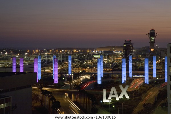 AUGUST 2007 - Aerial view of LAX Los Angeles International Airport at sunset with decorative light tubes, Los Angeles, California
